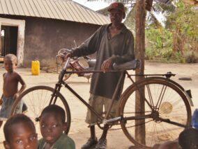 Village elder with bike